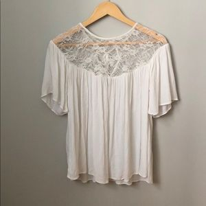 Flowy white blouse with lace detail